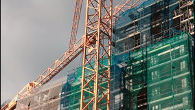 Cranes on construction site stock video