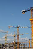 Cranes at the construction site of residential building Stock Photo