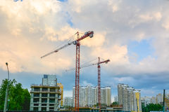 Cranes are on the construction site of residential buildings Royalty Free Stock Image