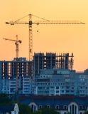 Cranes at construction site Stock Photos