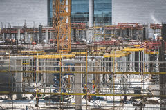 Cranes and construction workers onconstruction site Royalty Free Stock Image