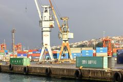 Cranes and containers Stock Image