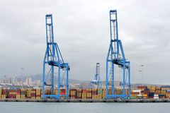 Cranes and containers on the dock Royalty Free Stock Image