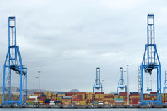 Cranes and containers on the dock Royalty Free Stock Photography
