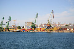 Cranes and containers at harbour Royalty Free Stock Image