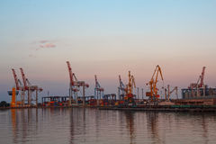 Cranes, containers and railway wagons in the seaport Royalty Free Stock Image