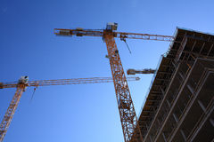 Cranes on contruction site Stock Images