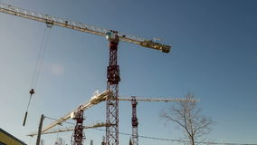Two cranes on construction site. Time lapse.. Cranes working on construction site. Full HD timelapse-video stock video
