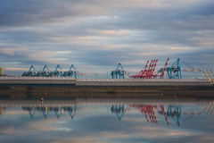 Cranes in Crosby. Blue and red cranes in Crosby, Merseyside Stock Image