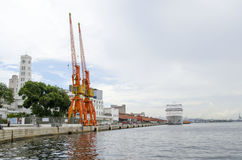 Cranes and cruise ship Stock Image