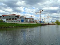 Cranes on a docking site. On the river Royalty Free Stock Image