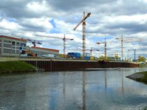 Cranes on a docking site. On the river Royalty Free Stock Photography
