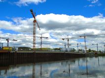 Cranes on a docking site. On the river Royalty Free Stock Photos