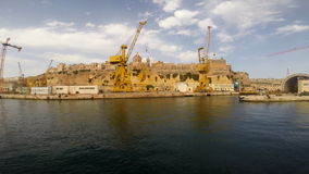 Cranes and docks on the shore of Malta stock video