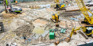 Cranes and Excavators in construction site. royalty free stock image