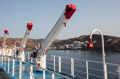 Cranes on a ferry in Greece. Foreground image of cranes on a ferry Paros island in the background Royalty Free Stock Photos