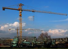 Cranes on a field ready for work. Cranes machineries on a filed of a construction site Royalty Free Stock Photography
