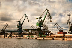 Cranes at Gdynia harbor. Cranes at the Gdynia harbor. Cloudy day. Poland Stock Photo