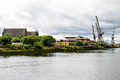 Cranes in Glasgow, Scotland. Clyde River view, Glasgow, Scotland, UK Royalty Free Stock Images