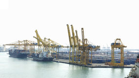 Cranes and goods in the port Royalty Free Stock Photography