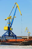 Cranes in a harbor Stock Photography