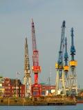 Cranes at the harbor. Cranes at harbor at sunset Stock Photo