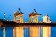 Cranes in harbor Stock Photo