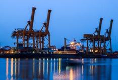 Cranes in harbor Stock Image