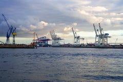 Cranes in a harbor Stock Photos