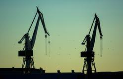 Cranes in Harbor at Twilight Stock Photo