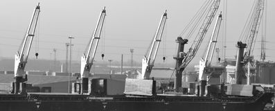 Cranes. At the harbor waiting for work Stock Photo