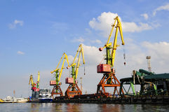 Cranes in harbour royalty free stock photo