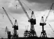 Cranes in harbour. Ship cranes in the port of Hamburg Stock Photos