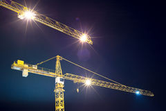 Cranes and illumination at night Royalty Free Stock Photo