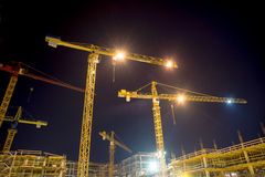 Cranes and illumination at night Royalty Free Stock Photo
