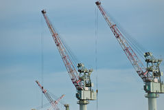 Cranes at an industrial port Royalty Free Stock Photos