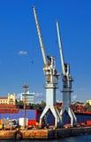 Cranes. Industrial cranes rising into sky Royalty Free Stock Photos