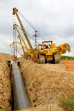 Cranes laying gas pipeline Royalty Free Stock Image