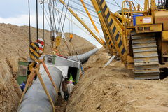 Cranes laying gas pipeline and welding cabin Stock Photos