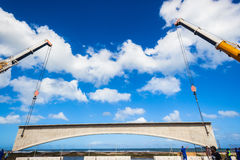 Cranes Lifting Bridge Section Royalty Free Stock Photography