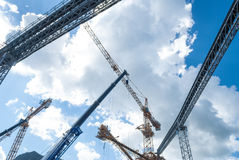 Cranes line and machinery at a construction site Royalty Free Stock Image