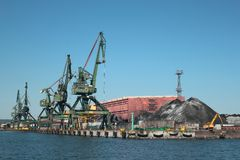 Cranes loading coal in port Stock Images