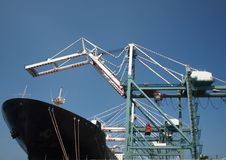 Cranes are Loading a Large Ship Stock Photos
