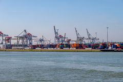 Cranes and lots of containers in the container terminal, Rotterdam harbor. royalty free stock photo