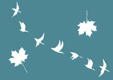 Cranes and maple leafs Stock Photography
