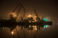 Cranes at midnight in the calm bay Royalty Free Stock Photos