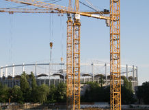 Cranes near National Arena. Three cranes in the Mega Mall construction site in Bucharest, near National Arena. The Mega Mall is being built on the site of the Royalty Free Stock Photo
