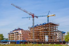 Cranes and new modern buildings. Royalty Free Stock Images