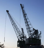 Cranes  at night, construction site Stock Photos