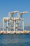 Cranes in Oakland port. Alameda, CA - March 9, 2015: Oakland Container Shipyard loading/unloading cranes royalty free stock image